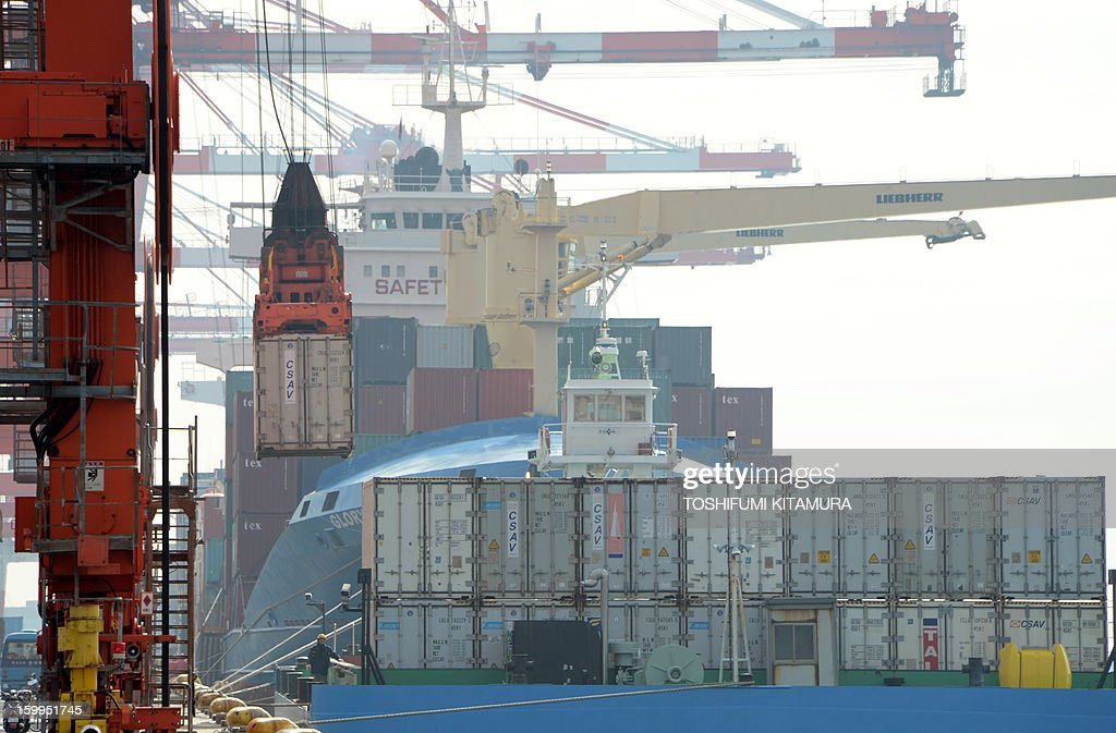 A container is loaded onto a freighter at the pier in Tokyo port on January 24, 2013. Japan said it logged a record trade deficit in 2012, Japan's exports totalled 63.7 trillion yen against imports of 70.7 trillion yen, as exports to debt-hit Europe plunged and a bitter diplomatic spat with its biggest trade partner China weighed on demand. AFP PHOTO / TOSHIFUMI KITAMURA