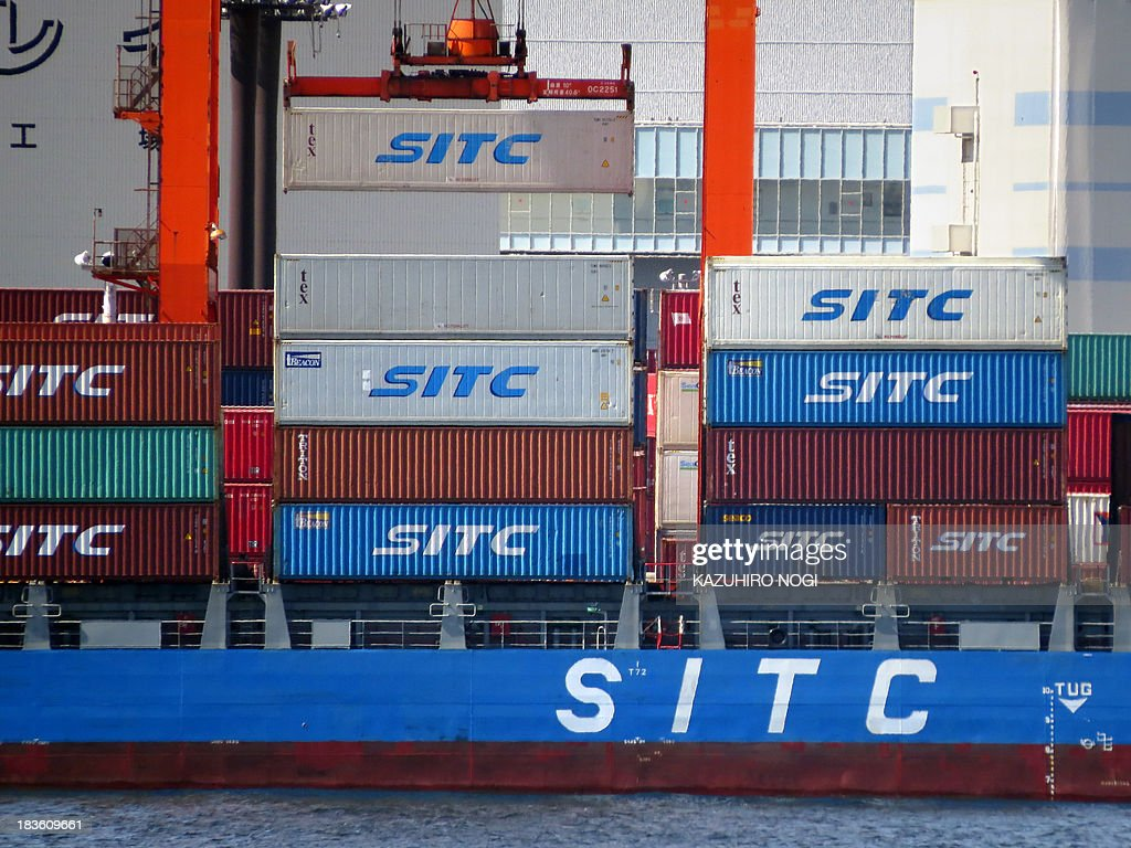 A container is unloaded from a cargo ship at a container wharf in Tokyo port on October 8, 2013. Japan's current account surplus was a sharply lower-than-expected 161.5 billion yen ($1.67 billion) in August.