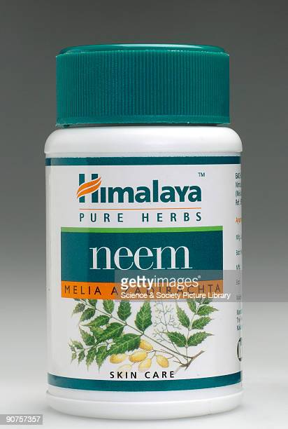 Container of Neem tablets a herbal medicine for skin care used by practitioners of Ayurveda manufactured by The Himalaya Drug Company Bangalore India...