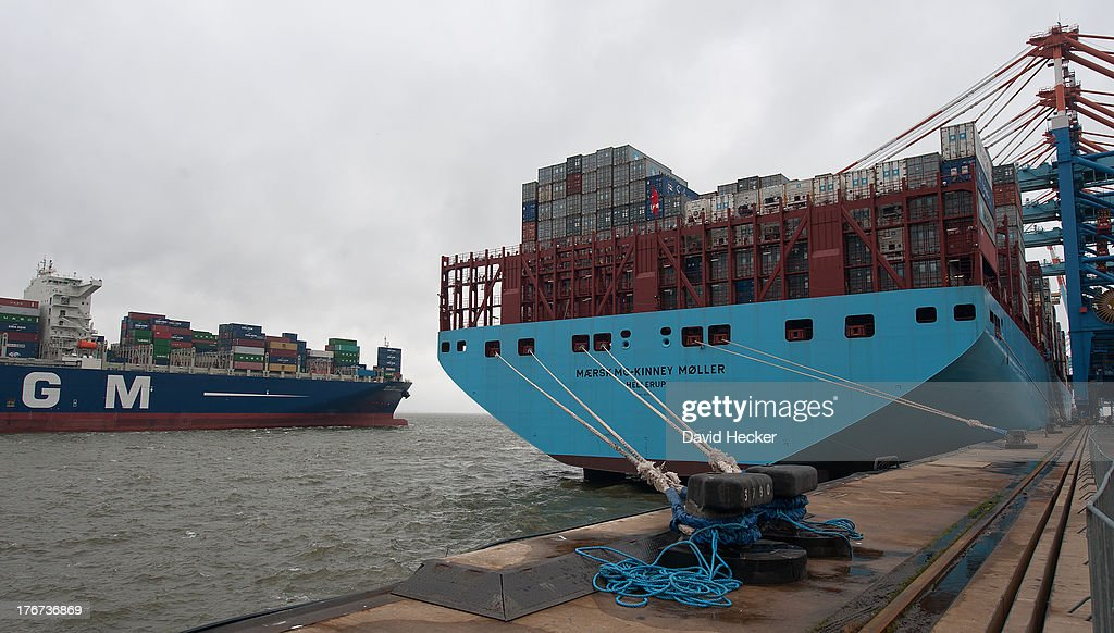 Container ship Alexander von Humboldt (left) leaves the port of Bremerhaven on Sunday, August 18, 2013 Bremerhaven, Germany. To the right is the world's largest container ship, the Maersk MC-Kinney Moller, lies at the port of Bremerhaven. It has a length of 400 meters, it is 59 meters in wide and is capable of delivering 18.000 TEU Containers. The ship carries the first Triple-E Standard (Economy of Scale, Energy Efficiency, Environmentally-improved) and is the most efficient and energy saving container ship in the world.