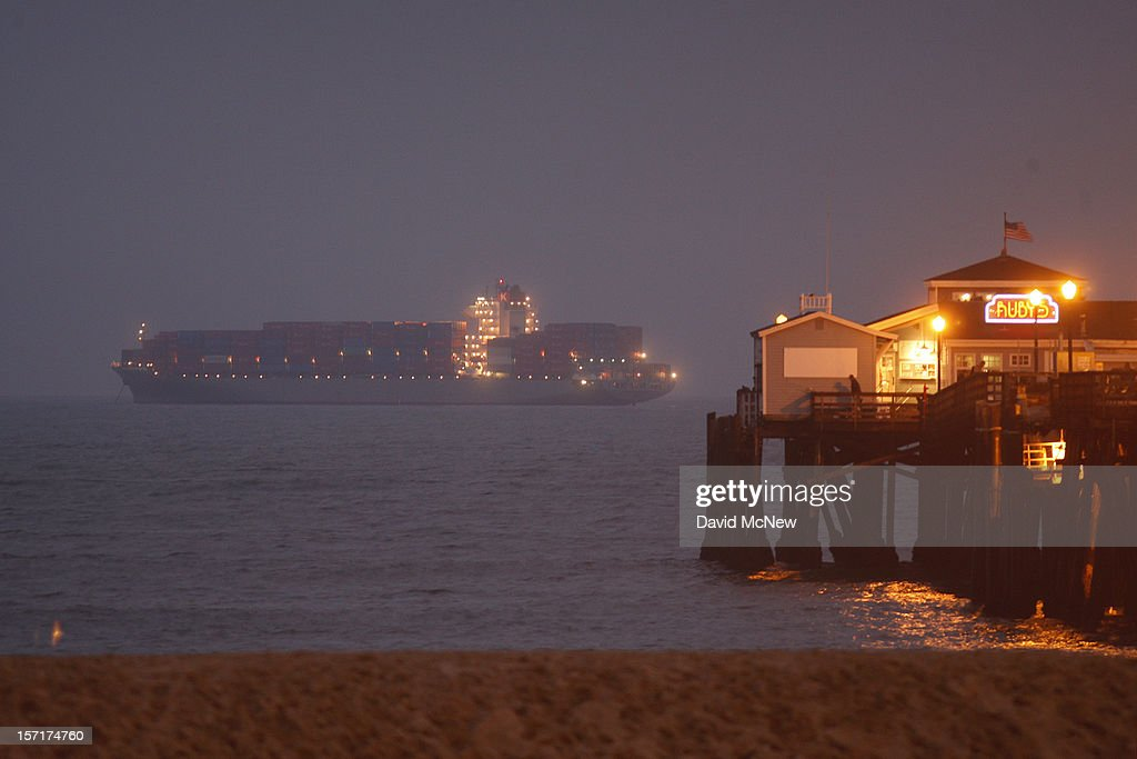 A container ship anchored offshore from the Seal Beach Pier is one of several that cannot enter the ports of Los Angeles and Long Beach to load and unload cargo because of a strike by the International Longshore and Warehouse Union Local on November 29, 2012 in Seal Beach, California. The strike is the largest work stoppage at the ports since a lockout by shipping companies in 2002, which prompted President George W. Bush to intervene with a court injunction to resolve the standoff.
