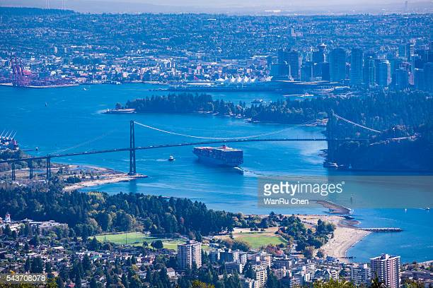 container ship and lions gate bridge