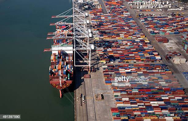 Container ship APL Raffles operated by Neptune Shipmanagement Services Ltd sits moored during cargo loading operations at the container terminal...