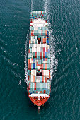 Container ship at sea, aerial view