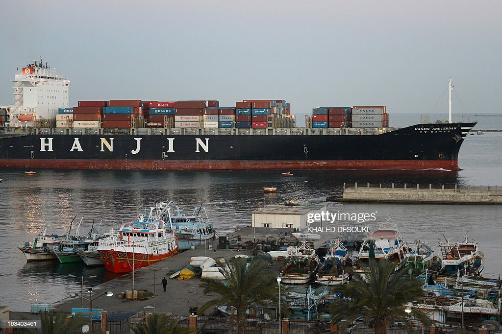 A container ship, belonging to Korea's Hanjin shipping, sails down the Suez Canal city of Port Said on March 9, 2013. Traffic in the Suez Canal, a vital waterway for global commerce, has not been disrupted by the clashes between security forces and protesters in Port Said, the canal authority said.