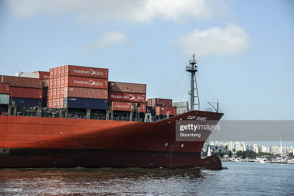 A container ship departs the Port of Santos in Santos, Brazil, on Friday, July 5, 2013. Rising borrowing costs and the global bond selloff triggered by the prospect of reduced U.S. stimulus are prompting Brazilian investors to boost holdings of the countrys floating-rate securities. Photographer: Paulo Fridman/Bloomberg via Getty Images