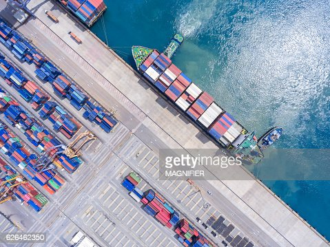 container ship in import export and business logistic.By crane , : Stock Photo