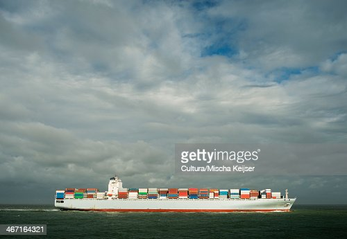 Container ship in Rotterdam harbor : Stock Photo
