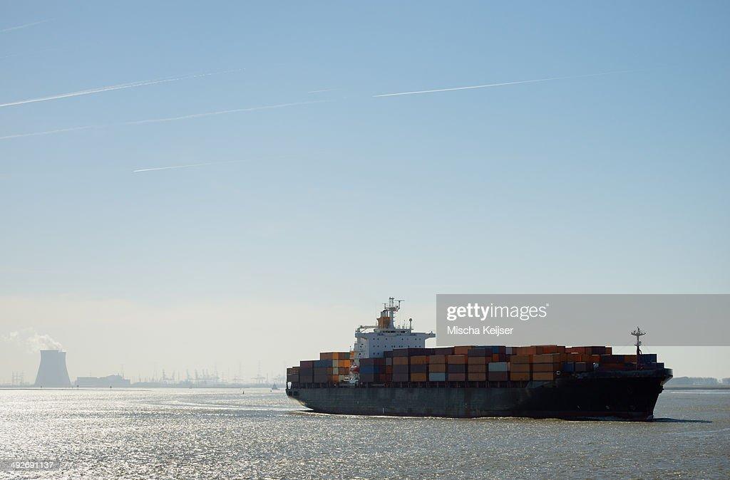 Container ship leaving Antwerp harbor, Belgium