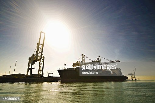 Container ship moored while in operation in port. : Stock Photo