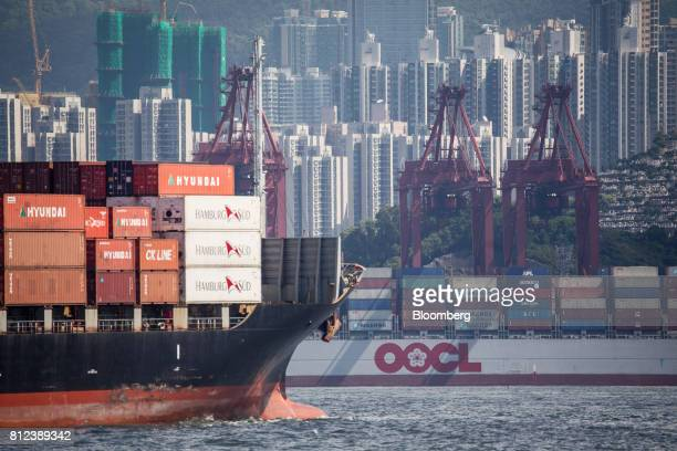 A container ship operated by Orient Overseas Container Line a unit of Orient Overseas International Ltd right sits berthed at the Kwai Tsing...
