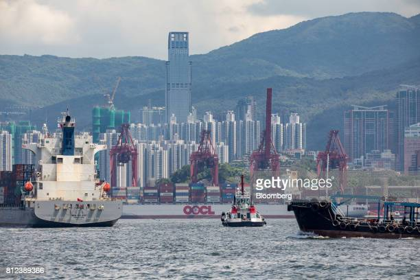 A container ship operated by Orient Overseas Container Line a unit of Orient Overseas International Ltd rear sits berthed at the Kwai Tsing Container...