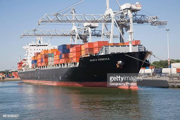 Container ship Santa Rebecca and cranes Port of Rotterdam Netherlands