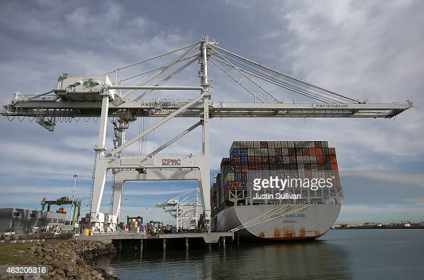 A container ship sits docked in a berth at the Port of Oakland on February 11 2015 in Oakland California A work slowdown at West Coast ports...