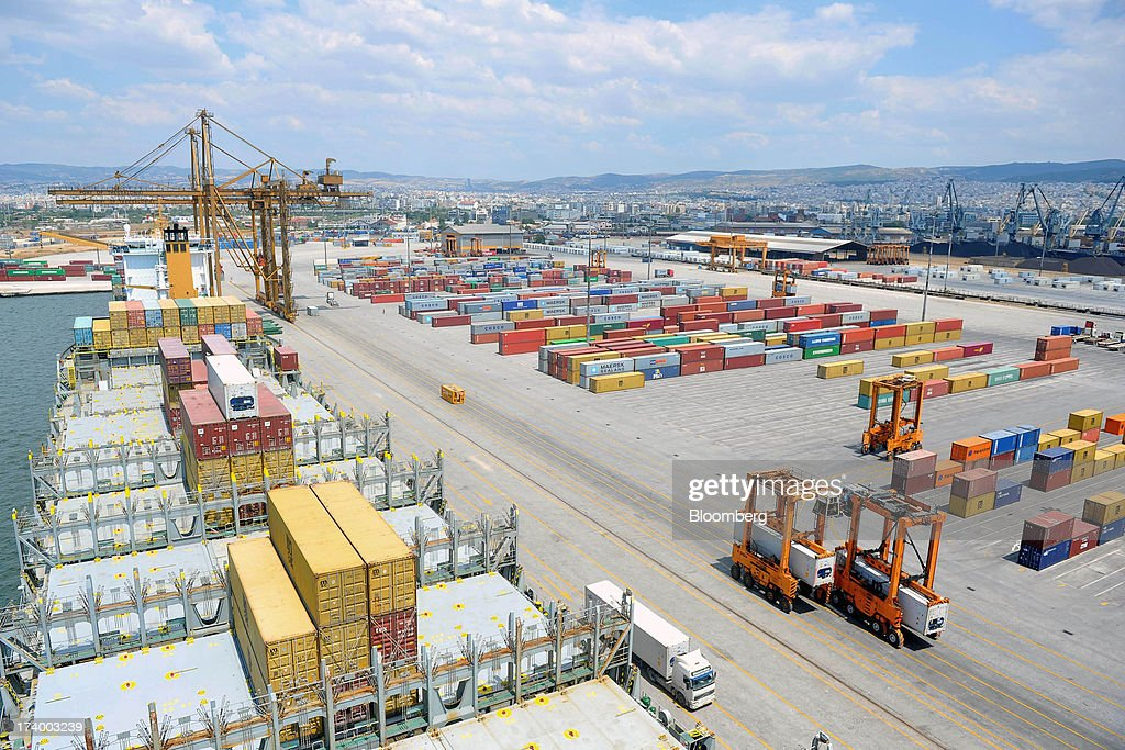 A container ship stands on the dockside beside shipping containers at Thessaloniki Port, operated by Thessaloniki Port Authority SA, in Thessaloniki, Greece, on Thursday, July 18, 2013. Russian Railways is interested in buying Thessaloniki Port and Greek rail operator Trainose SA as one single unit, newspaper Real News reported, citing an interview with the Russian company's CEO Vladimir Yakunin. Photographer: Oliver Bunic/Bloomberg via Getty Images