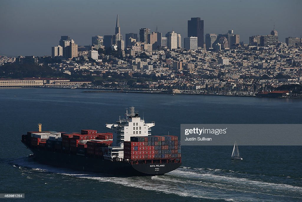 A container ship travels through the San Francisco Bay enroute to the Port of Oakland on February 20 2015 in San Francisco California Members of...