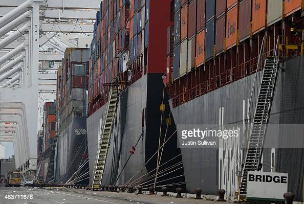 Container ships sit docked in a berth at the Port of Oakland on February 17 2015 in Oakland California Dockworkers at 29 West Coast ports from Los...