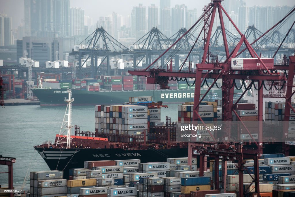 Container ships sit moored next to shipping containers and gantry canes at the Kwai Tsing Container Terminals, operated by Hong Kong International Terminal (HIT), a unit of CK Hutchison Holdings Ltd., in Hong Kong, China, on Friday, March 17, 2017. CK Hutchison is scheduled to release earnings results on March 22. Photographer: Anthony Kwan/Bloomberg via Getty Images