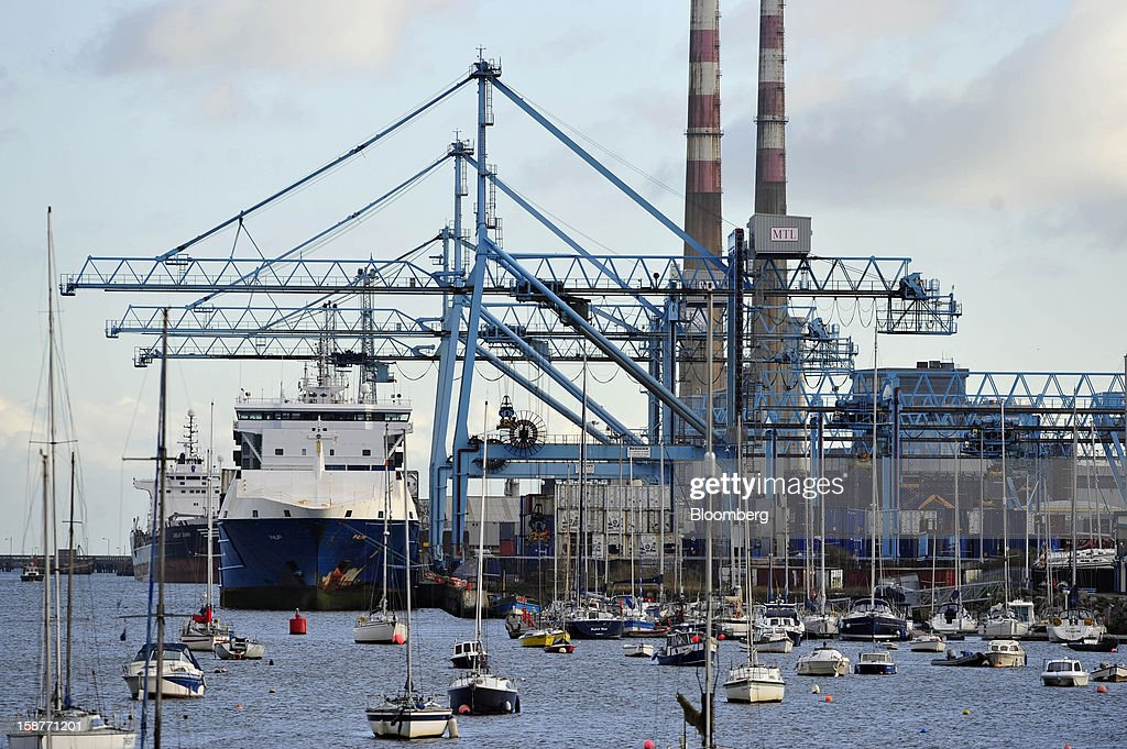 Container ships sit moored to the quayside at Dublin Port in Dublin, Ireland, on Thursday, Dec. 27, 2012. Ireland will take over the EU presidency in January as the euro-area wrestles with putting the European Central Bank in charge of lenders within the currency union and other participating nations. Photographer: Aidan Crawley/Bloomberg via Getty Images