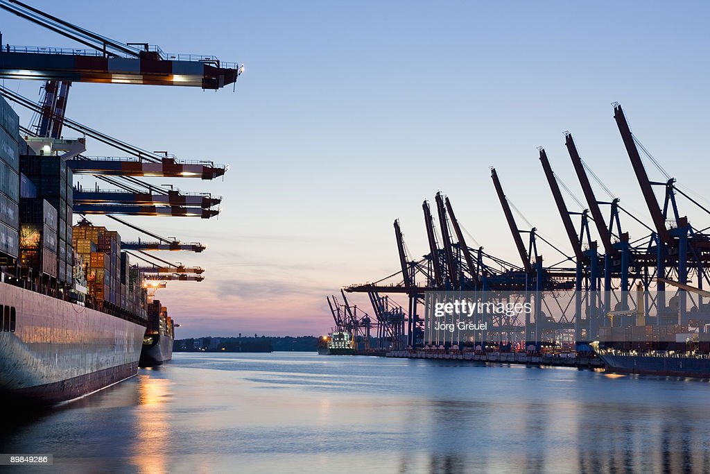 Container terminal at dusk : Stock Photo