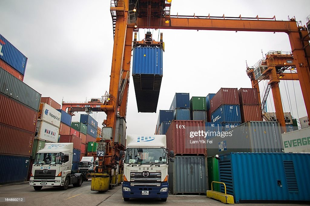 Container trucks and shipping containers stand unattended during industrial action at the Kwai Chung Container Terminal on March 29, 2013 in Hong Kong, China. Over 100 workers, who are employed by Hongkong International Terminals, have taken strike action as they demand higher wages, claiming that that they have not received a pay raise in 15 years.
