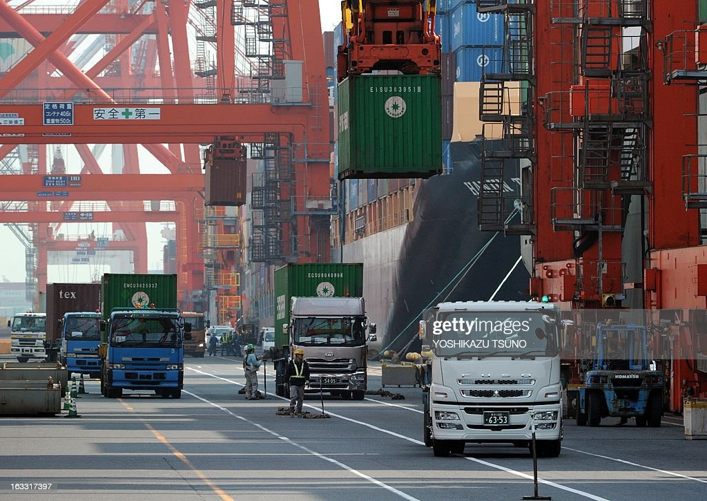 Container trucks leave a container yard at the international cargo terminal in Tokyo on March 8, 2013. Japan posted its third straight current account deficit in January, as trade losses swelled on the weakening yen and strong energy imports, the government said. AFP PHOTO / Yoshikazu TSUNO