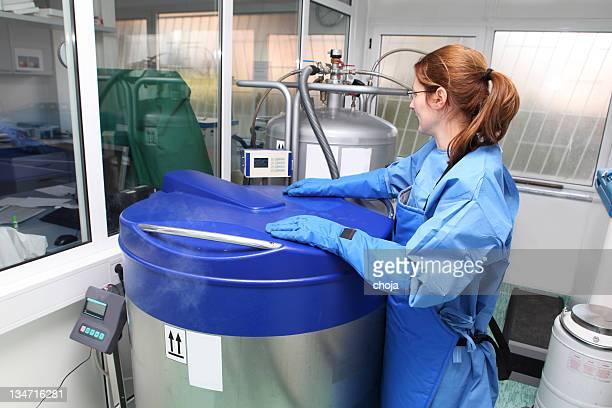 Container with liquid nitrogen...doctor in hazmat suit at work