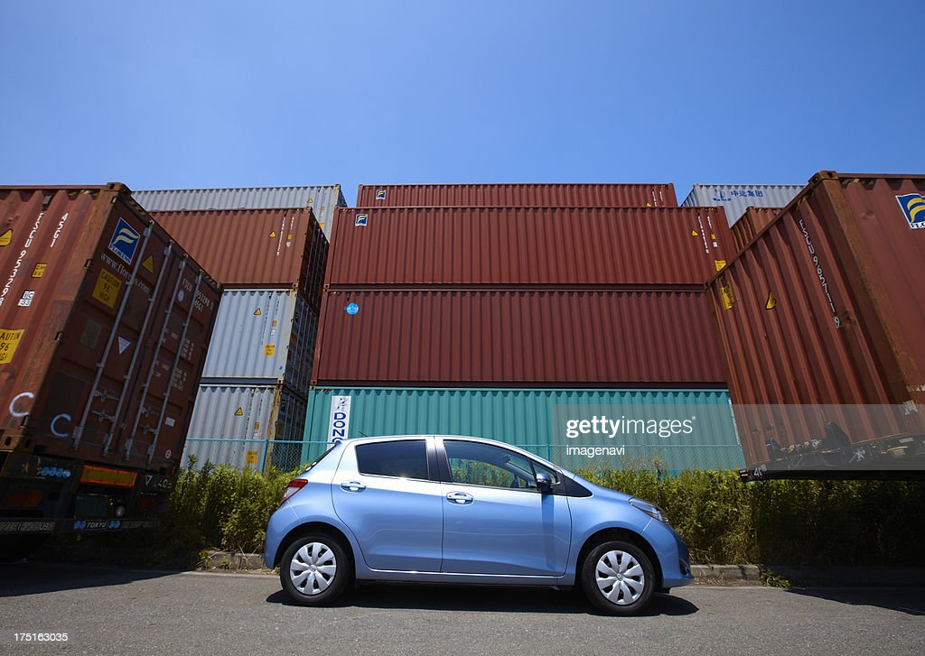 Containers and a car : Stock Photo