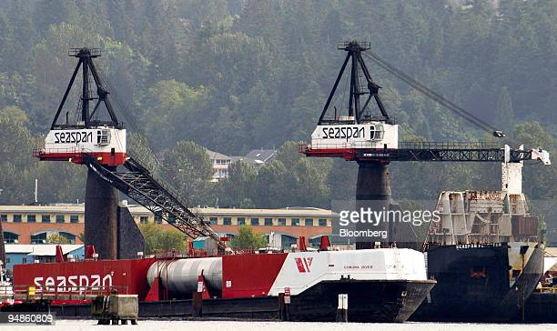 Containers are loaded onto Seaspan Corp ships at the company's dock in Vancouver British Columbia Canada on Tuesday July 22 2008 Seaspan is Canada's...
