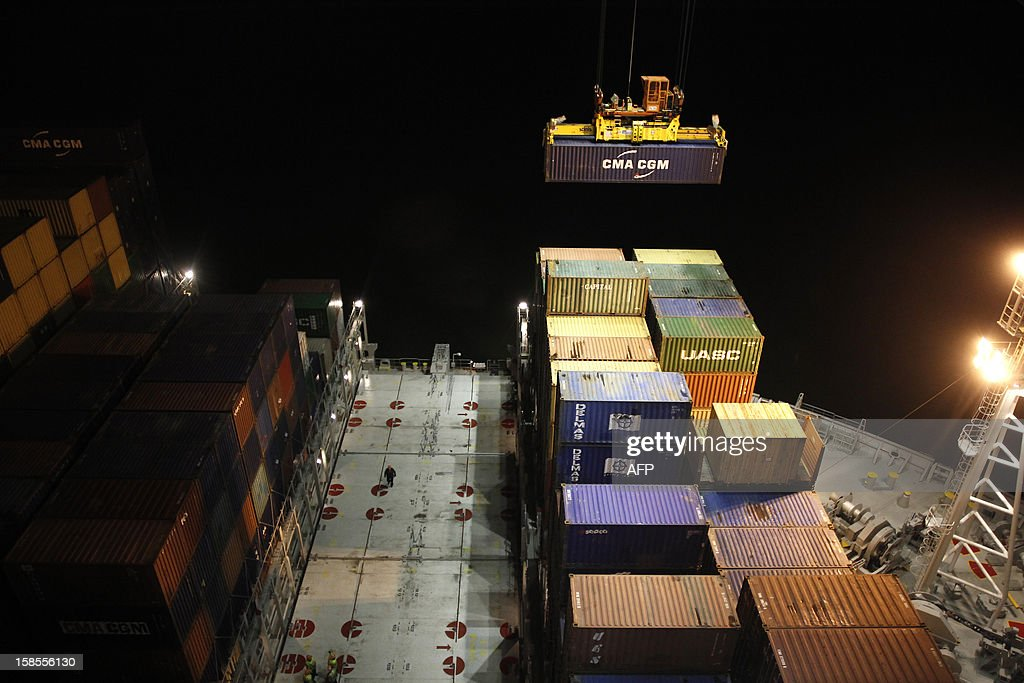 Containers are see on the Marco Polo, flying a British flag and said to be the world's biggest container ship by French owners CMA CGM, moored in the port of Le Havre, western France, early on December 19, 2012. The Marco Polo was given its champagne christening in the Belgian port of Zeebrugge on December 18, 2012. The ship, which is 396 metres (yards) long -- the length of four football fields -- was built in South Korea and was to head back to Asia after a stop in France. It is said to be the largest container in the world measured by capacity, as it can hold 16,020 TEU (twenty-foot equivalent unit containers) -- or 97 kilometres of containers lined up one by one.