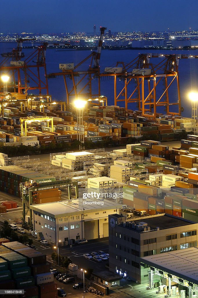 Containers are stacked at a shipping terminal in Tokyo, Japan, on Tuesday, Dec. 18, 2012. Japan's exports fell for a sixth month in November and the trade deficit swelled, underscoring the challenge that incoming Prime Minister Shinzo Abe faces in reviving growth. Photographer: Kiyoshi Ota/Bloomberg via Getty Images