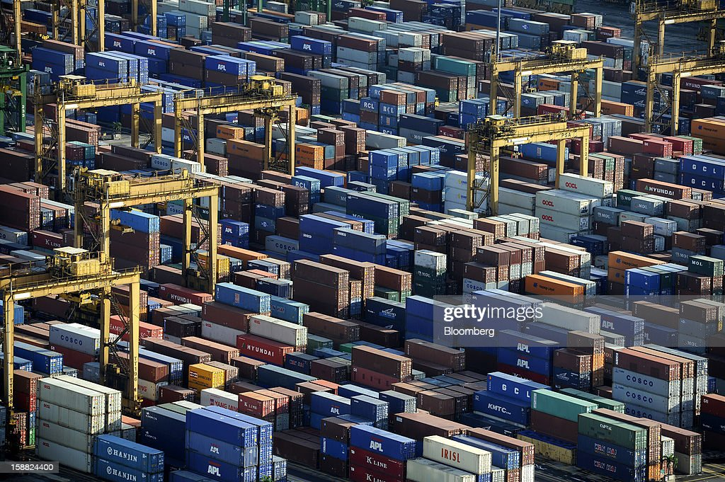 Containers are stacked at the port in Singapore, on Friday, Dec. 28, 2012. Singapore may grapple with elevated inflationary pressures for a third year in 2013, reducing scope for the central bank to provide stimulus to an economy that probably entered a technical recession this quarter. Photographer: Munshi Ahmed/Bloomberg via Getty Images