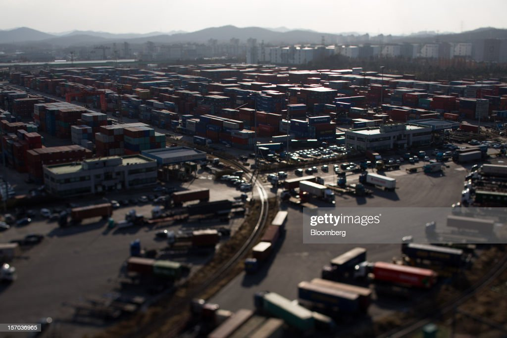 Containers are stacked at the Uiwang Inland Container Depot (ICD), in this photo taken with a tilt-shift lens, in Uiwang, South Korea, on Monday, Nov. 26, 2012. South Korea's current-account surplus narrowed to a two-month low after imports of machinery and equipment increased. Photographer: SeongJoon Cho/Bloomberg via Getty Images