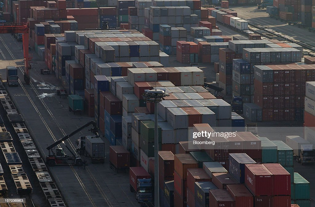 Containers are stacked at the Uiwang Inland Container Depot (ICD) in Uiwang, South Korea, on Monday, Nov. 26, 2012. South Korea's current-account surplus narrowed to a two-month low after imports of machinery and equipment increased. Photographer: SeongJoon Cho/Bloomberg via Getty Images