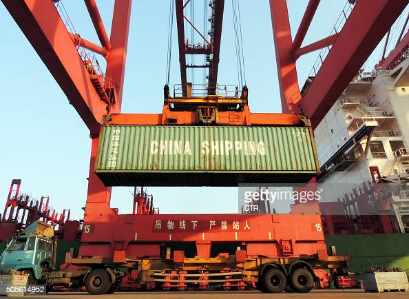 Containers are transported at a port in Lianyungang eastern China's Jiangsu province on January 19 2016 China's GDP grew at its slowest in a quarter...
