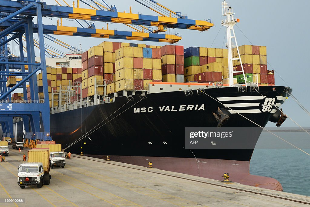 Containers are unloaded from the MSC Valeria, an ultra-large containership from the Mediterranean Shipping Company S. A., of Geneva, at Adani Ports and Special Economic Zone at Mundra, some 400 Km from Ahmedabad on June 4, 2013. India's industrial output accelerated by a surprise 2.5 percent in March, its fastest pace in five months, data showed Friday, fuelling hopes that a sharp economic slowdown could be bottoming out. The economy has been struggling under the weight of high interest rates in the face of uncomfortably strong inflation and sluggish investment amid fears about graft and disappointment with the slow pace of government economic reforms. AFP PHOTO/ Sam PANTHAKY