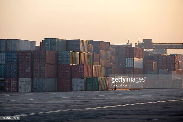 Containers at port during sunrise
