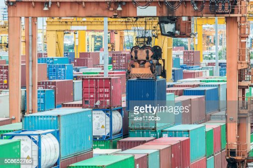 Containers in the port for import export : Stock Photo