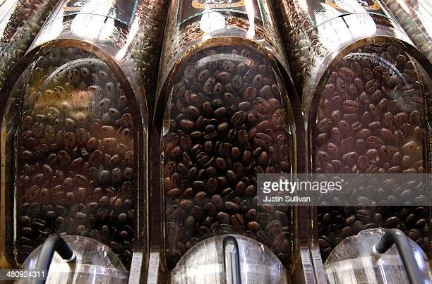 Containers of bulk coffee beans are displayed at CalMart Grocery on March 27 2014 in San Francisco California Food prices are on the rise and...