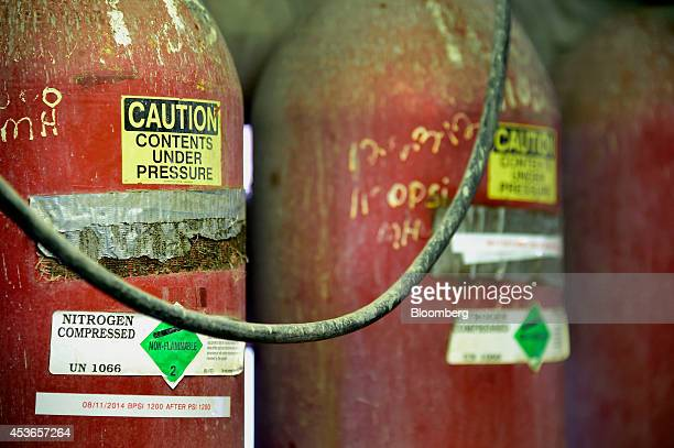Containers of compressed nitrogen are seen at an Anadarko Petroleum Corp oil rig in Fort Lupton Colorado US on Tuesday Aug 12 2014 US crude oil...