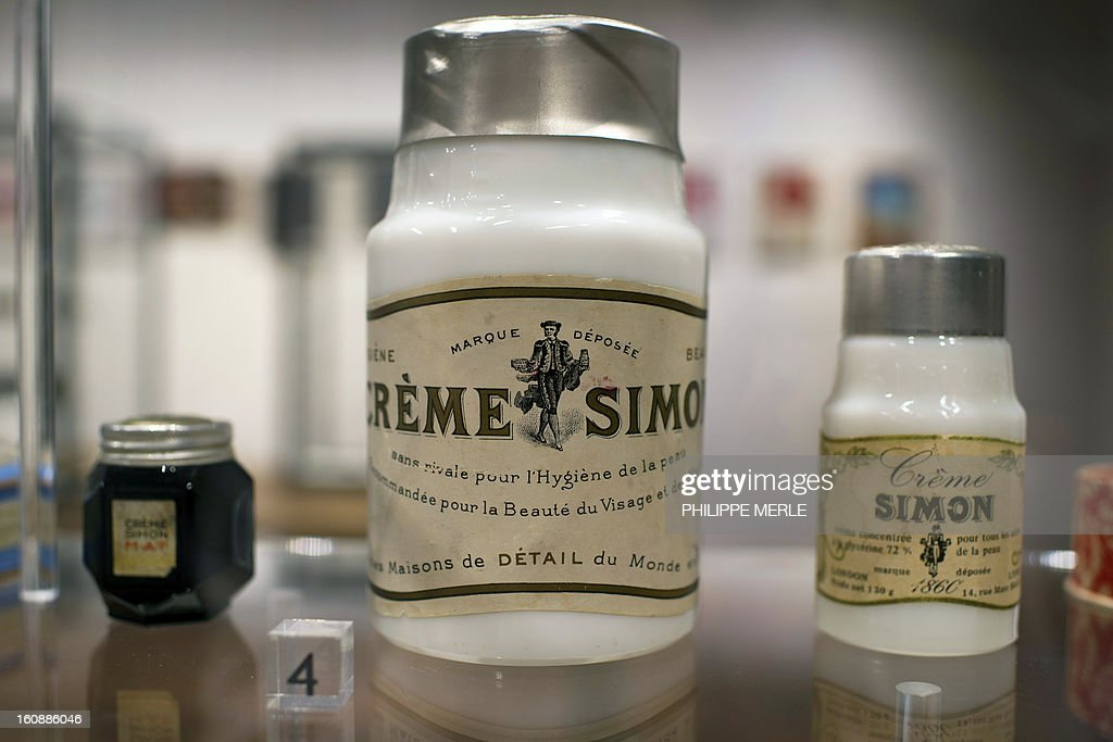 Containers of cosmectics are displayed on February 7, 2013 at the Gadagne Museum in the central french city of Lyon. After Hong Kong, Lyon opened on February 7 an exhibition of more than 200 rare pieces of beauty and makeup products: from 17th century boxes of beauty spots and whitening powders to sophisticated contemporary blush boxes, reflecting the evolution of women's makeup. AFP PHOTO / PHILIPPE MERLE