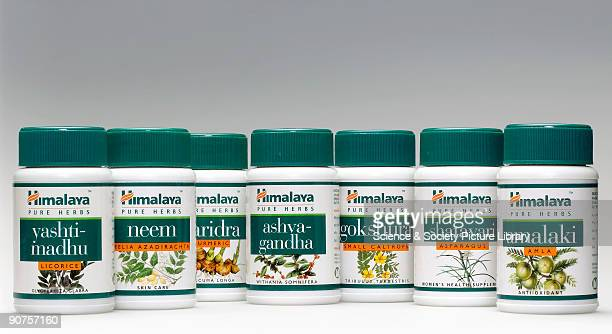 Containers of herbal medicine used by practitioners of Ayurveda Manufactured by The Himalaya Drug Company Bangalore India and distributed by Vedic...