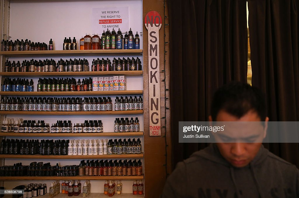 Containers of juice for E-cigarettes are displayed at Gone With the Smoke Vapor Lounge on May 5, 2016 in San Francisco, California. The U.S. Food and Drug Administration announced new federal regulations on electronic cigarettes that will be the same as traditional tobacco cigarettes and chewing tobacco.