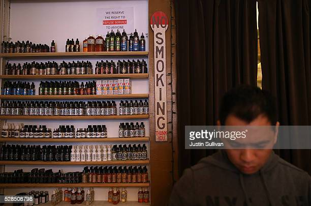 Containers of juice for Ecigarettes are displayed at Gone With the Smoke Vapor Lounge on May 5 2016 in San Francisco California The US Food and Drug...