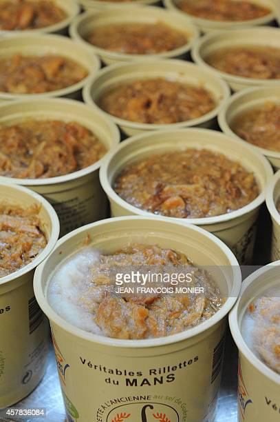 Containers of 'rillettes' a meat preparation similar to pate chill at the Charcuterie Cosme in Le Mans western France on October 25 2014 The...
