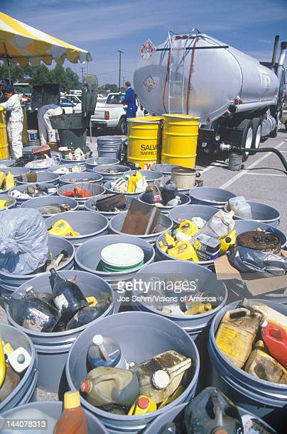 Containers of used oil and other toxic household chemicals awaiting further disposal at a Unocal station in Los Angeles California
