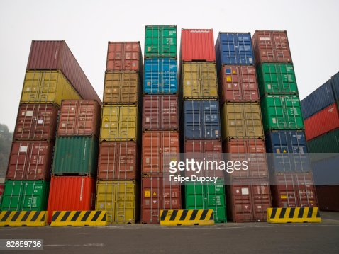 Containers stacked up in a shipping yard : Stock Photo
