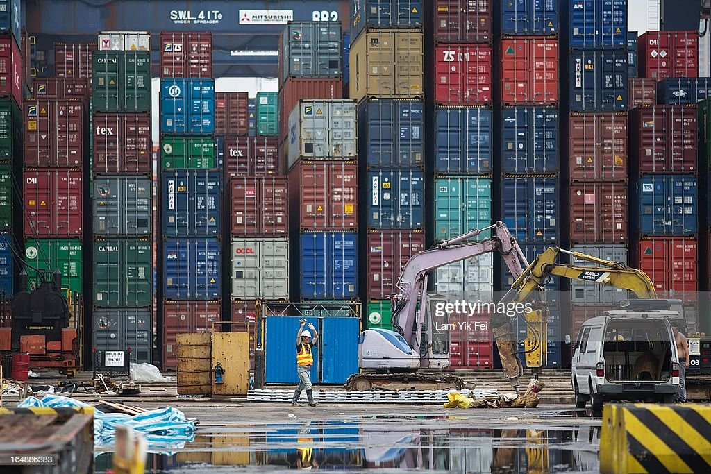 Containers stand stacked at the Kwai Chung Container Terminal on March 29, 2013 in Hong Kong, China. Over 100 workers, who are employed by Hongkong International Terminals, have taken strike action as they demand higher wages, claiming that that they have not received a pay raise in 15 years.