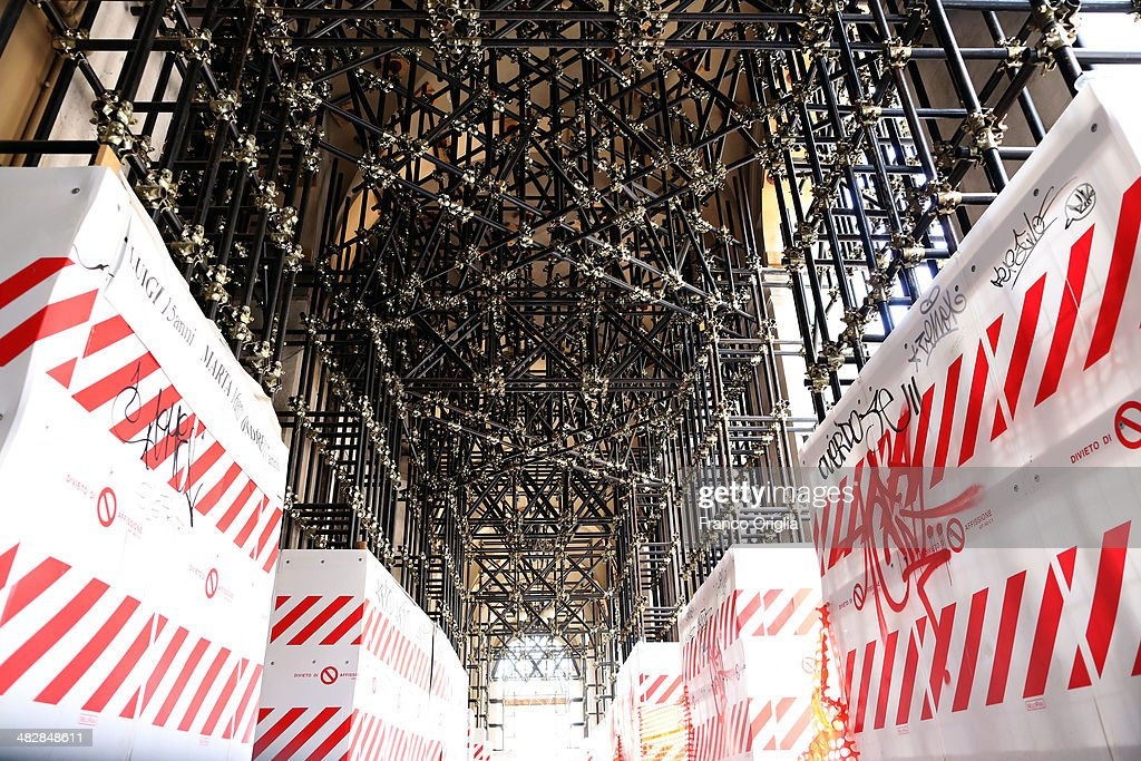 L'AQUILA ITALY MARCH 22 Containment scaffoldings are seen in the historical centre of L'Aquila five years after the earthquake on March 22 2014 in...