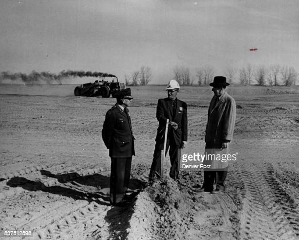 Contaminated Mud Removed Arsenal information officer Harry Barton project engineer Claude Dabney and arsenal chief of engineering George Donnelly...